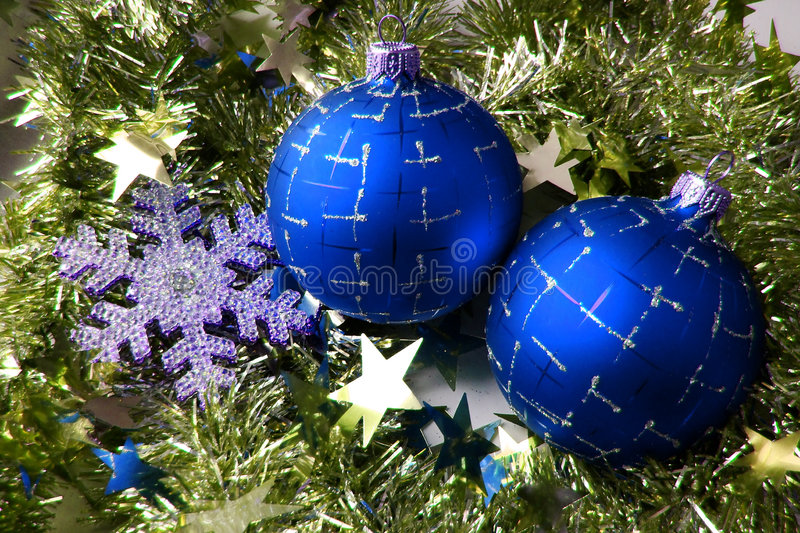 Christmas glass sphere. Of dark blue color with a pattern on a background of a celebratory tinsel royalty free stock images
