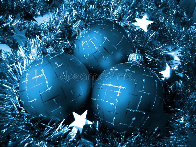 Christmas glass sphere. Of dark color with a pattern on a background of a celebratory tinsel royalty free stock photo