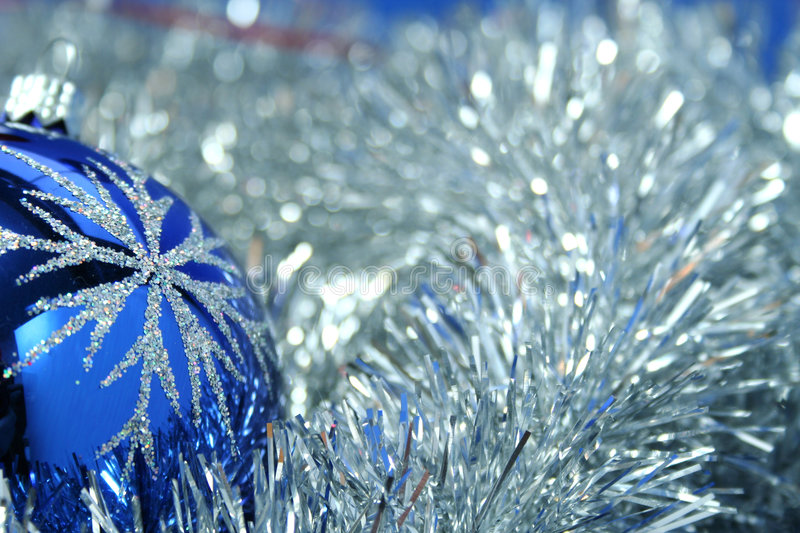 Christmas glass sphere of dark blue color 4. Christmas glass sphere of dark blue color with a pattern on a background of a celebratory tinsel royalty free stock photos