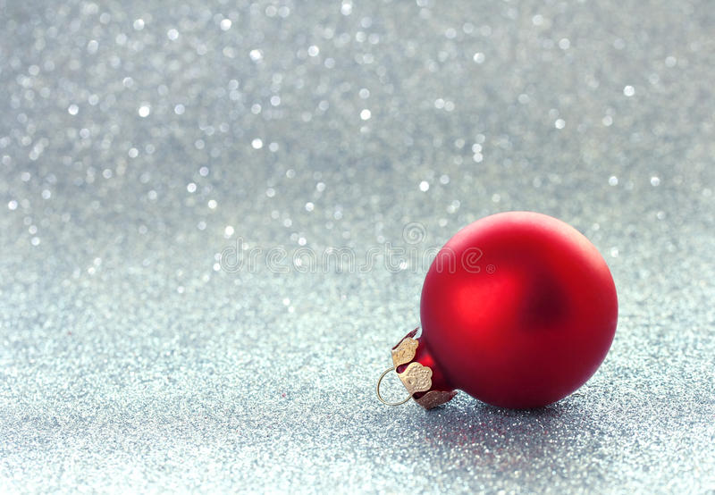 Christmas glitter background, red ball. Baubles, selective focus stock image
