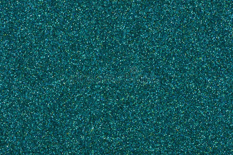 Christmas glitter background, texture in perfect blue tone for design look. royalty free stock photo