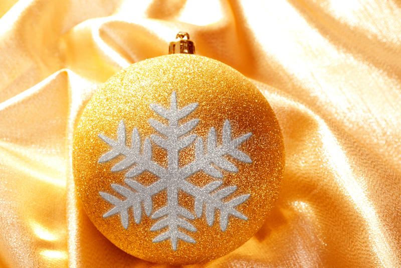 Christmas glitter golden snowflake bauble stock photo