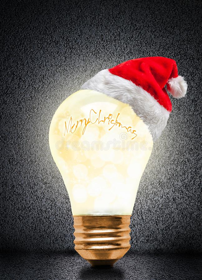 Christmas Glowing Light Bulb With Santa Hat And Copy Space royalty free stock image