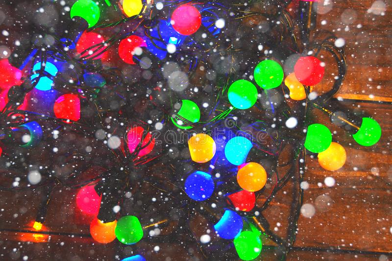 Christmas Glowing Lights and snow-double exposure. Merry Christmas and Happy New Year royalty free stock images