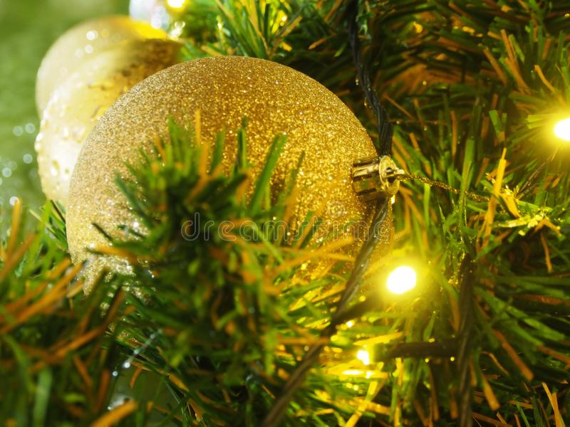 Christmas gold balls with light stock images