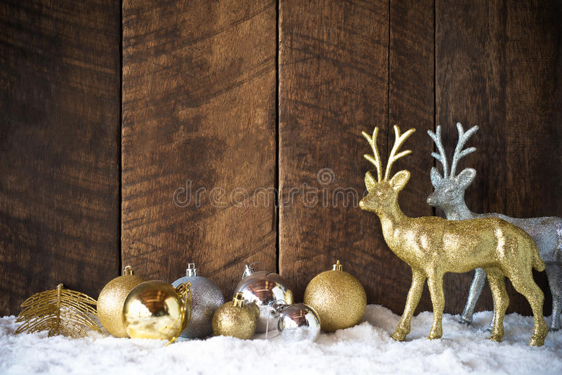 christmas gold silver ball and reindeer decoration with wood background royalty free stock photos