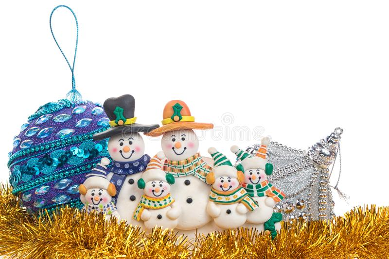 Christmas gold spangle with balls and snowman family decoration isolated on white. Background stock photos