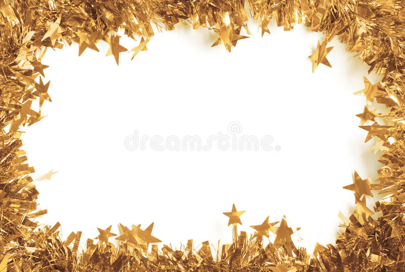 Christmas Gold Tinsel as a border isolated. Against a white background stock images