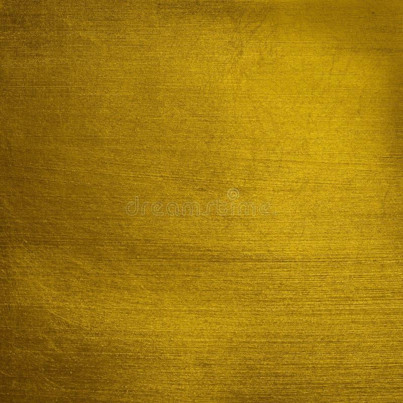 Damaged golden surface stock image