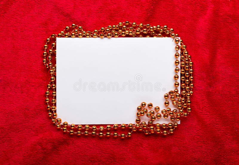 Christmas golden beads on red background.  stock photo