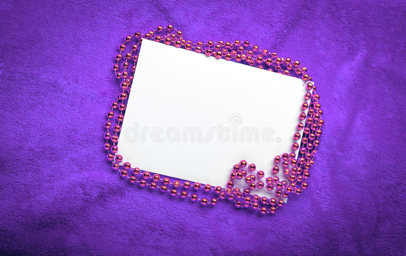 Christmas golden beads on violet background royalty free stock images