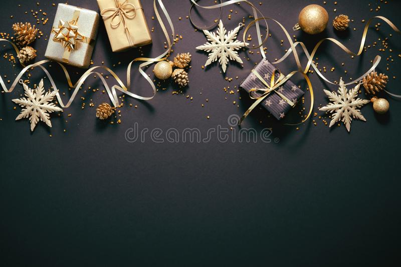 Christmas golden decoration on dark background royalty free stock photo