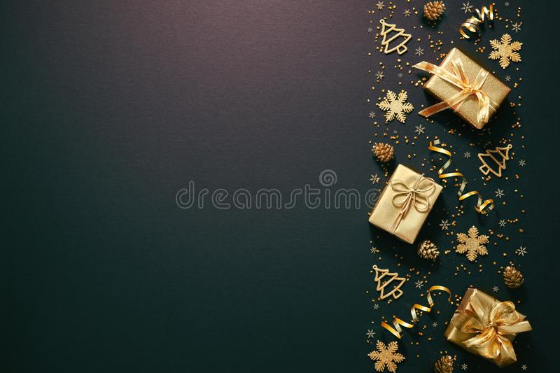 Christmas golden decoration on dark background stock photography