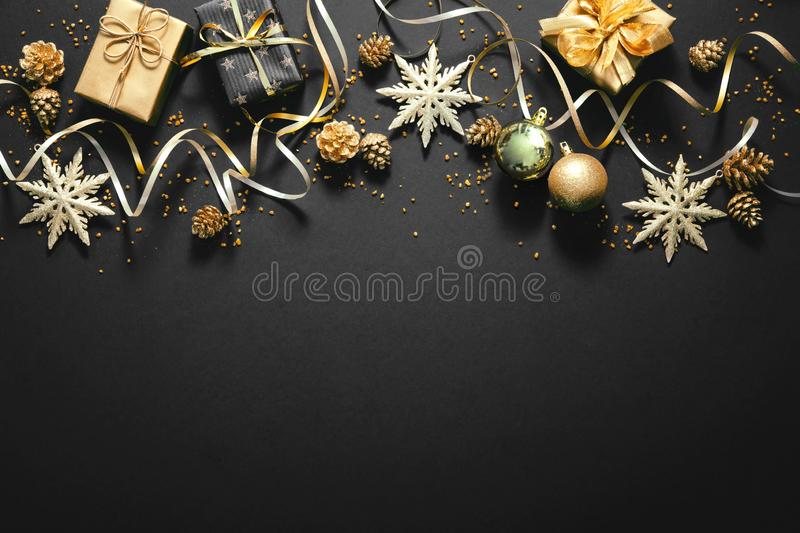 Christmas golden decoration on dark background stock photos
