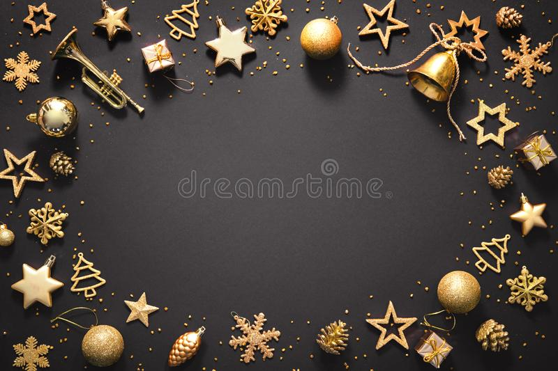Christmas golden decoration on dark background royalty free stock photos