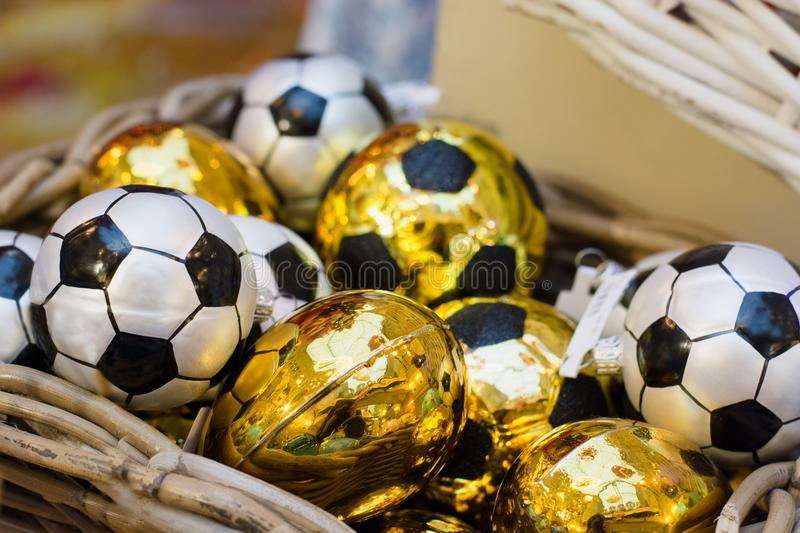 Christmas golden toy as soccer ball in basket. Xmas fair. Festive Holiday. Christmas market, fair. Close up. royalty free stock images