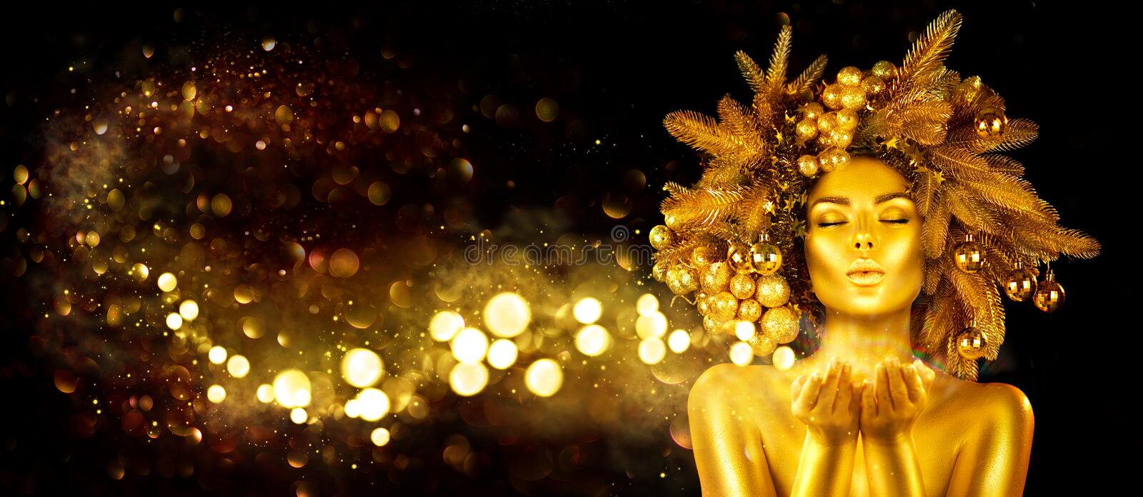 Christmas golden Woman. Winter girl pointing Hand, blowing, holding product Beautiful New Year, Christmas Tree Holiday Hairstyle stock photos