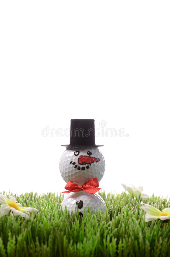 Christmas golfing. Concept, snow man with golf balls royalty free stock photography