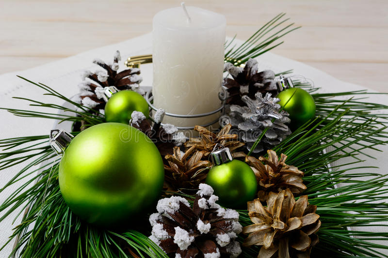 Christmas green ornaments and snowy pinecone decoration. Christmas background with shiny balls royalty free stock image