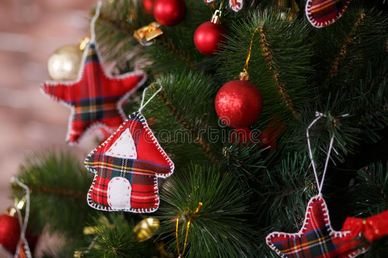 Christmas green pine tree decorated with red colourful toys stars balls sox and horse in studio shoot scene of new year holiday de. Corations stock photos