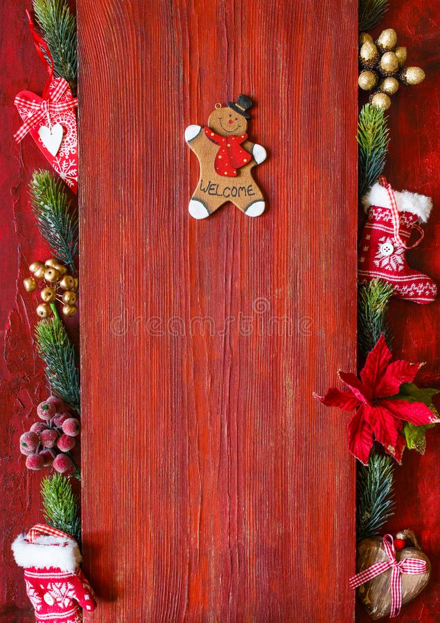 Christmas greeteng card with gingerbread man. Decorative wooden gingerbread man on vintage red background with copy space for greeteng, menu or your text stock images