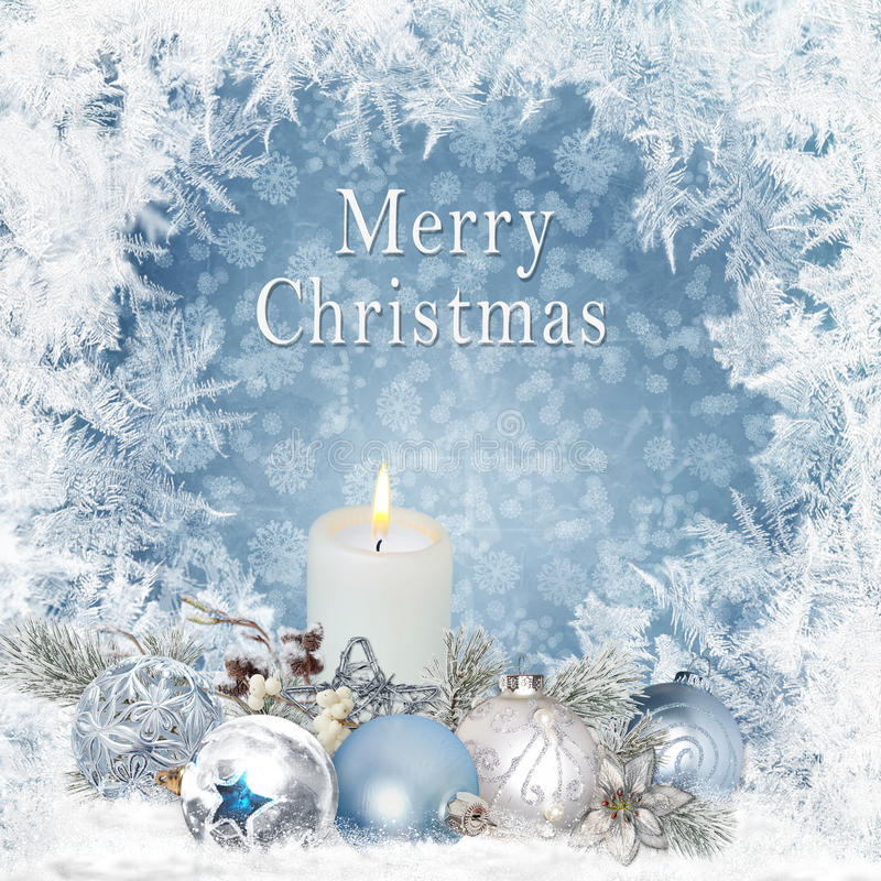 Christmas greeting background with candles, pine branches, balls on a blue background with a frosty pattern royalty free stock photography