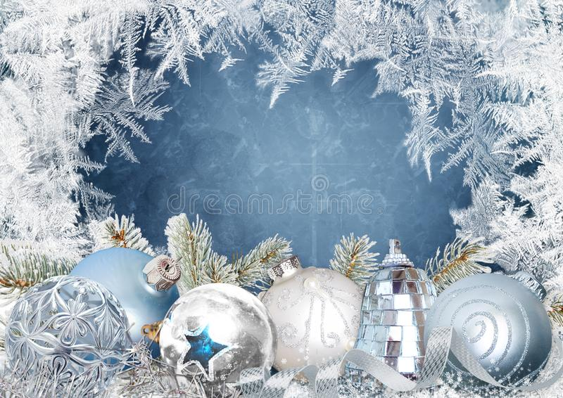 Christmas greeting card with beautiful balls on a blue snowy background with frosty patterns stock illustration