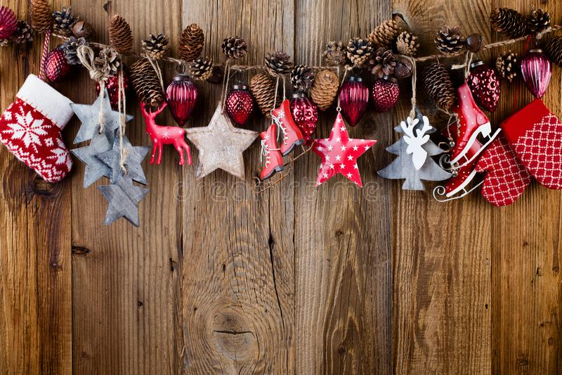 Christmas greeting card. Festive decoration on wooden background. New Year concept. Flat lay. Top view royalty free stock images