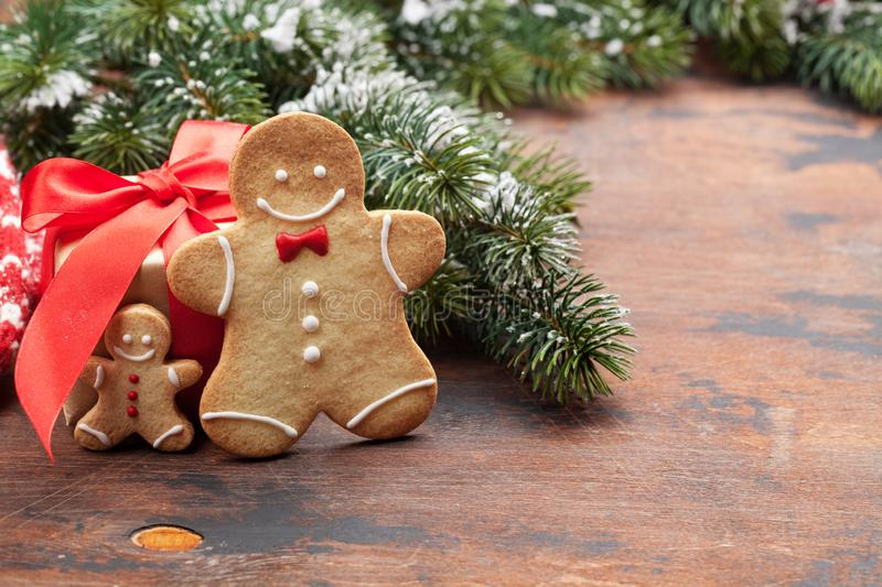Christmas greeting card with gingerbread cookies. And xmas gift box. With space for your greetings royalty free stock images