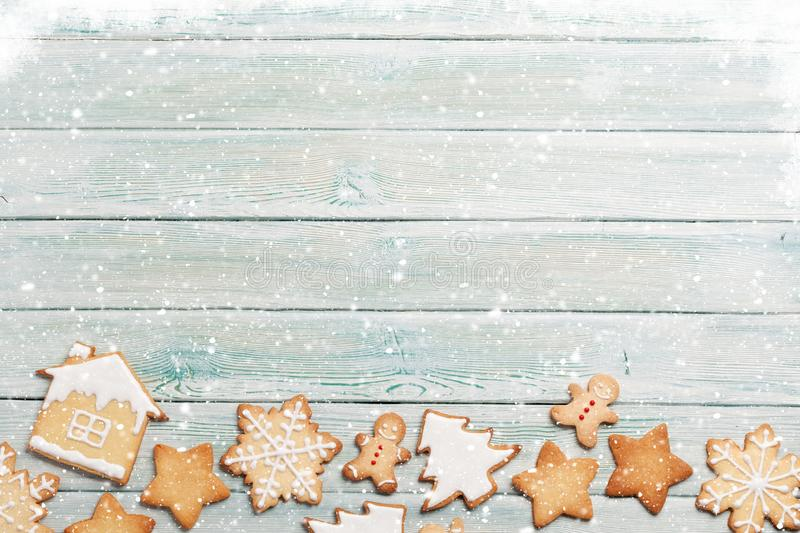Christmas greeting card with gingerbread cookies. Over wooden backdrop. Top view with space for your greetings royalty free stock photo