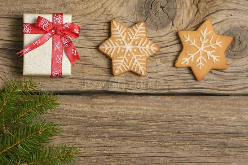 Christmas greeting card with gingerbread cookies and xmas gift box royalty free stock photography