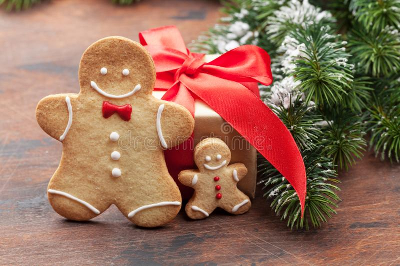 Christmas greeting card with gingerbread cookies. And xmas gift box. With space for your greetings stock photo