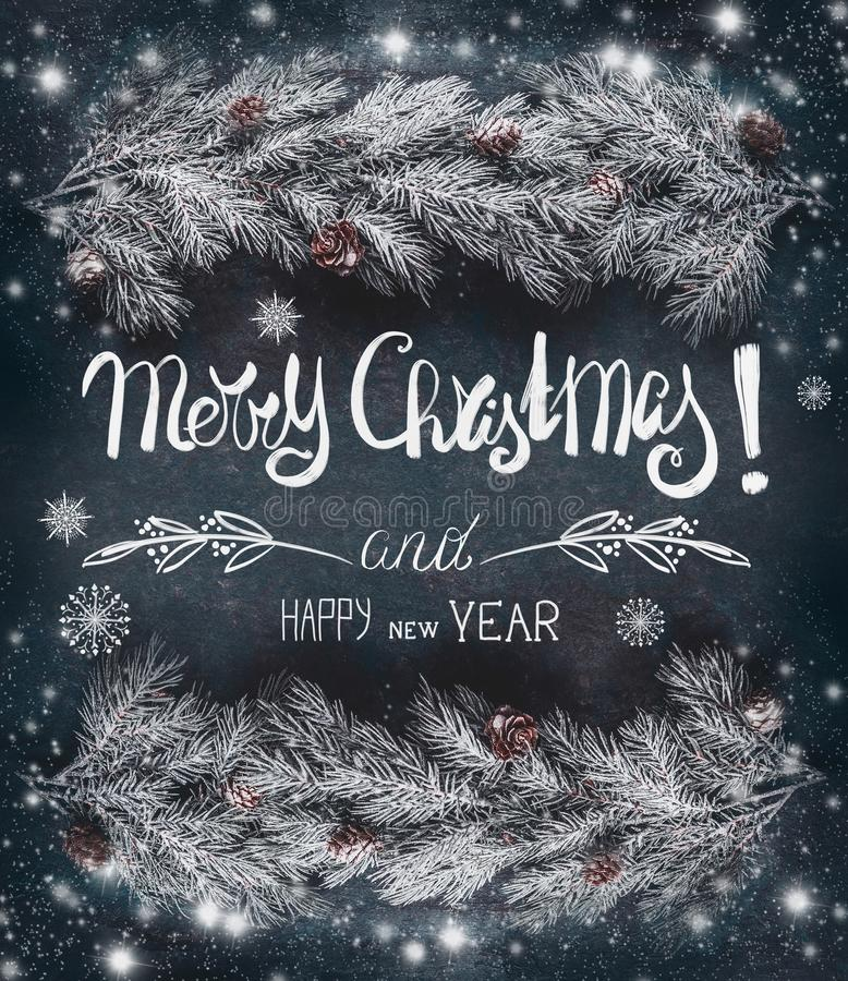 Christmas greeting card with hoar and snow covered fir branches with cones and text lettering: Merry Christmas and Happy New Year stock images