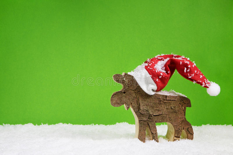 Christmas greeting card with reindeer in green red and white col. Merry christmas greeting card with reindeer in green red and white colors royalty free stock photo