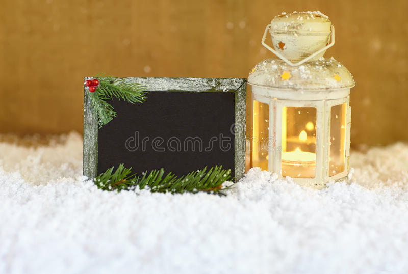Christmas greeting card. With snow, lantern and signboard royalty free stock photos