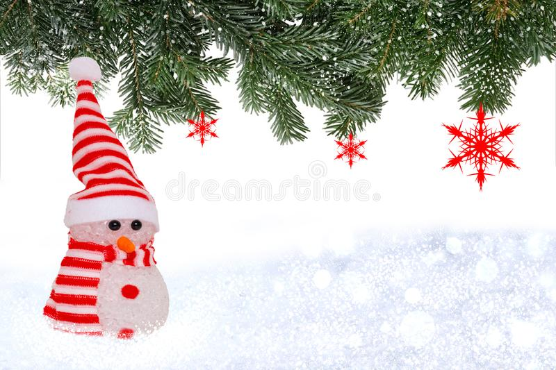 Christmas greeting card template. Christmas background with snowman in winter landscape and a border of fir branches with red stock photos