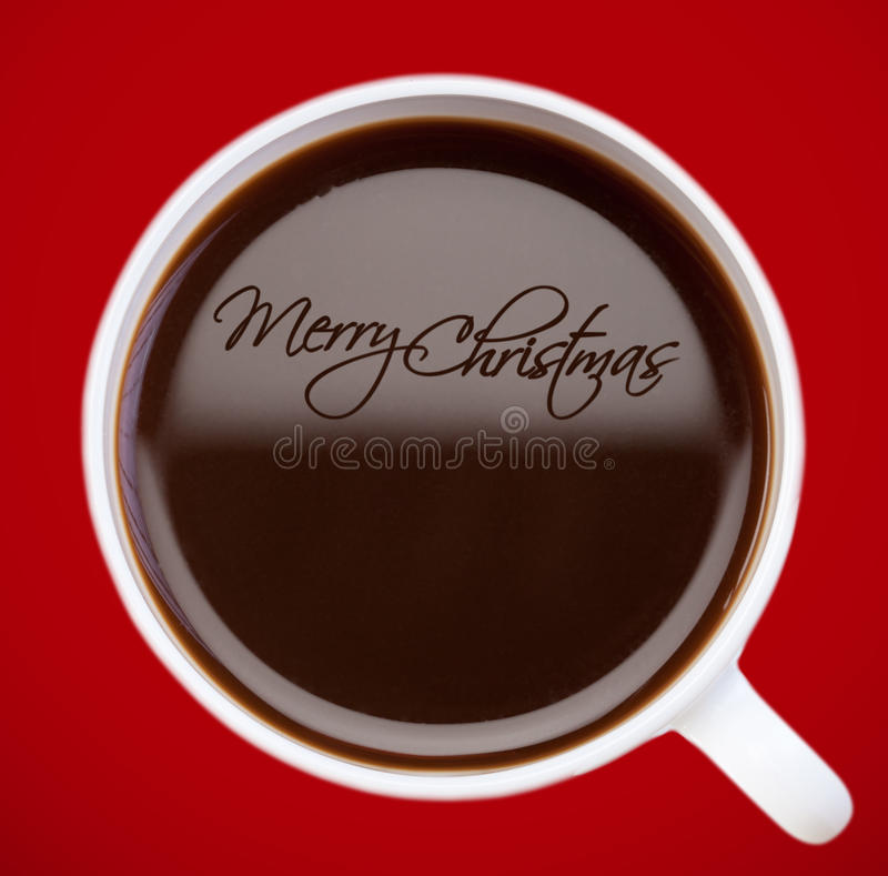 Christmas greeting , drawing on coffee surface royalty free stock photo