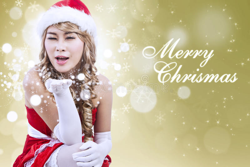 Christmas Greeting By Santa Woman In Golden Lights Stock Photos