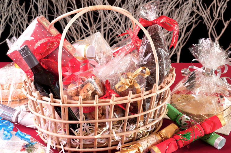 Christmas hamper basket. With a chocolate Santa, cookies and a bottle of wine stock images