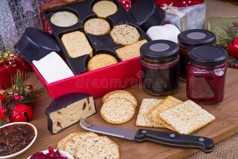 Cheese and Crackers Christmas Hamper. Christmas Hamper with a selection of Cheese, Crackers and Pickles royalty free stock image