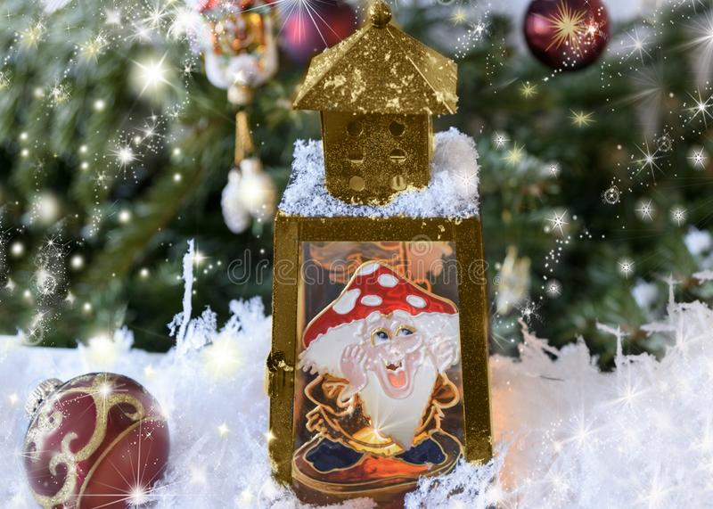Christmas handmade decorated lantern with a picture of fairy-tale amanita on the glass. New Year`s, Christmas still life. Christmas handmade decorated lantern stock images