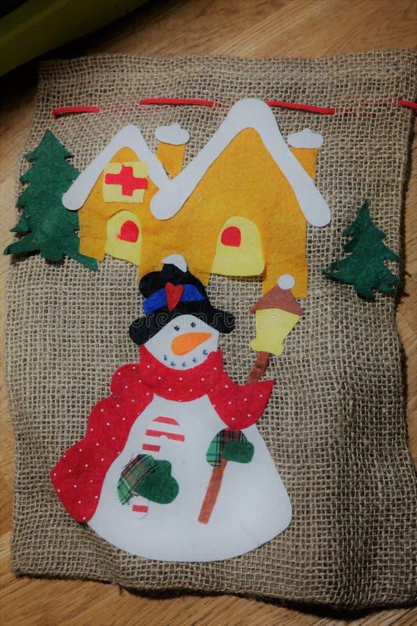 Christmas handmade gift bag, snowman. Christmas gift bag, handmade bag, decorated linen gift bag royalty free stock photography
