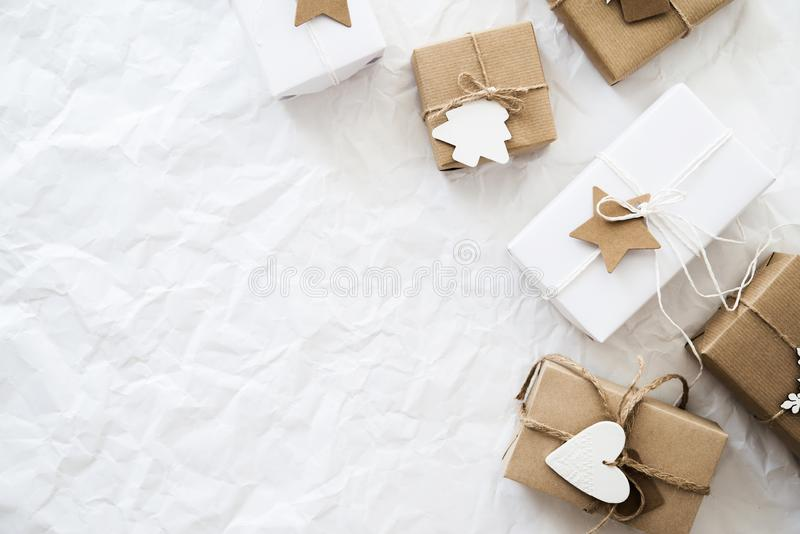 Christmas handmade gift boxes on white background top view. Merry Christmas greeting card, frame. Winter xmas holiday theme. royalty free stock photos
