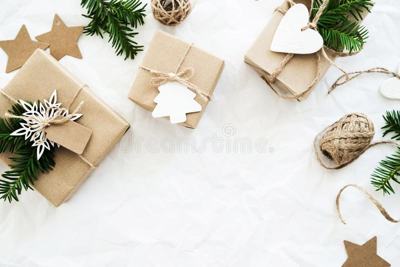 Christmas handmade gift boxes on white background top view. Merry Christmas greeting card, frame. Winter xmas holiday theme. royalty free stock images