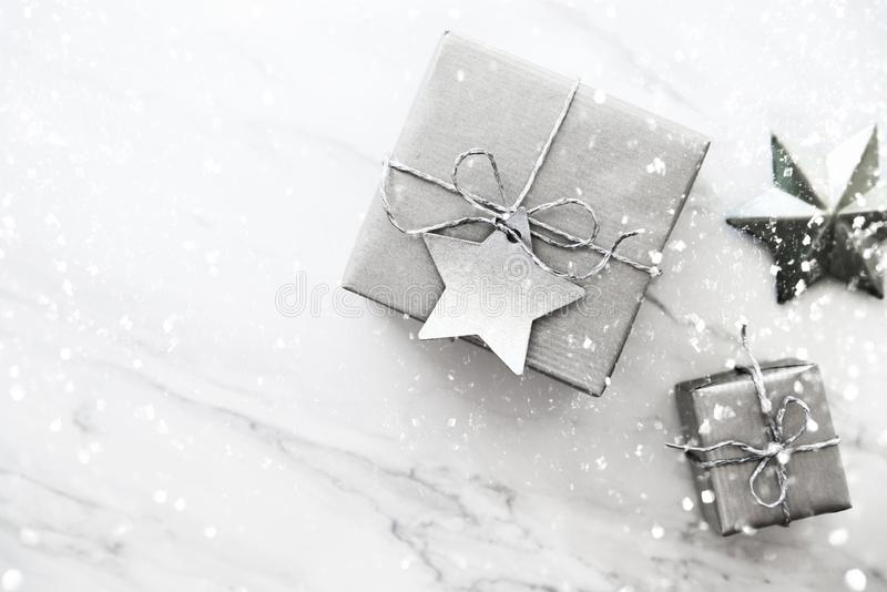 Christmas handmade gift boxes on white marble background top view. Merry Christmas greeting card, frame. Winter xmas holiday theme stock photography