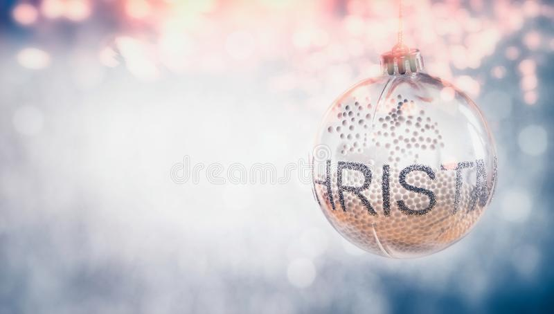 Christmas hanging ball at bokeh background, festive greeting card royalty free stock images