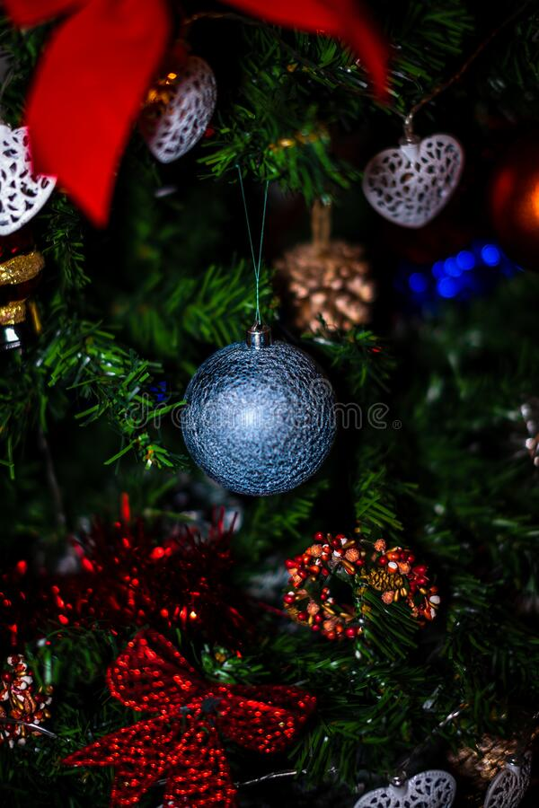 Free Christmas Hanging Decorations On Fir Tree. Decorated Christmas Tree. Fir Branch With Christmas Baubles Decorations Stock Photos - 194584803