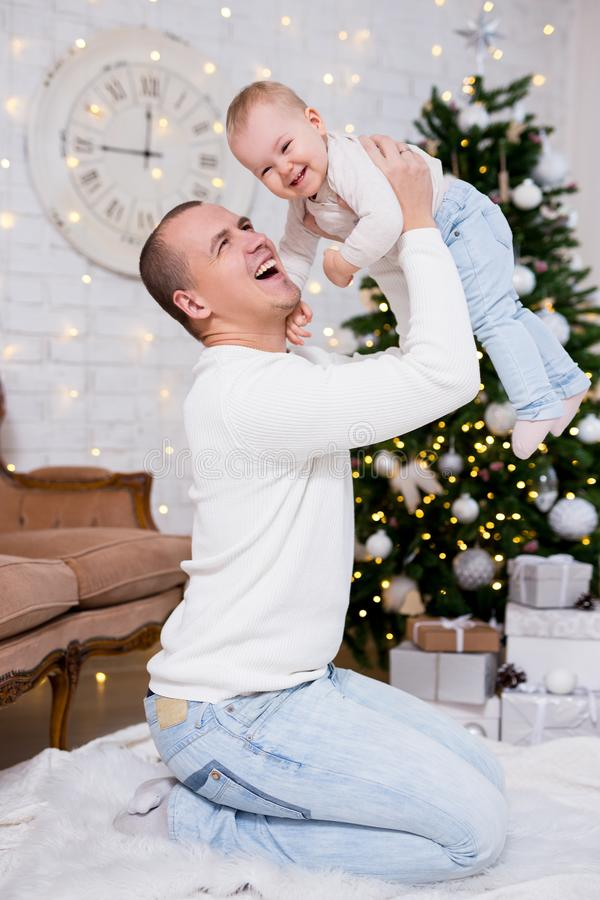 Christmas, happiness and family concept - happy father and little daughter near decorated christmas tree stock photography