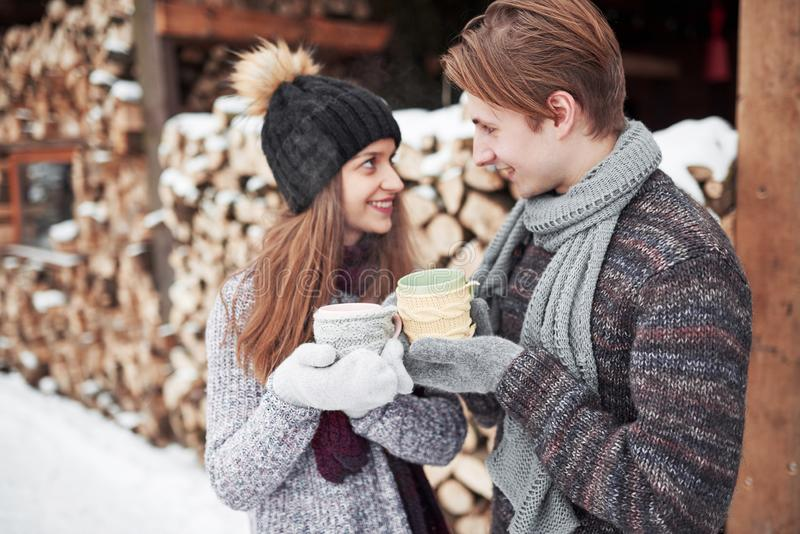 Christmas happy couple in love embrace in snowy winter cold forest, copy space, new year party celebration, holiday and. Vacation, travel, love and relations royalty free stock photos