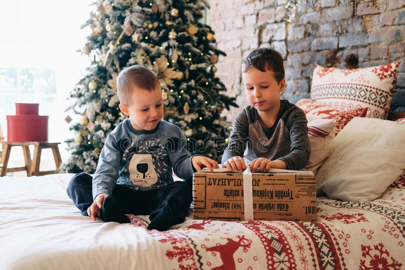Christmas happy funny brothers unpacking gift royalty free stock image